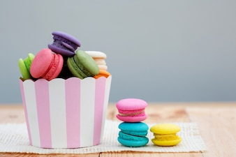 French colorful macarons on paper cup.