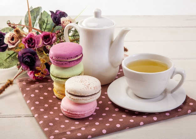 French colorful macarons on a wooden floor