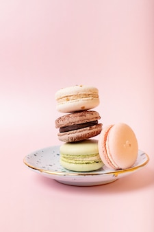 French colourful macaroons on pink