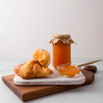 French croissant breakfast and jam
