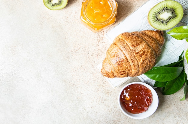 French croissant with jam and kiwi tasty croissant copy space