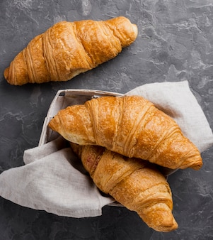 French croissants in cardboard box and cloth
