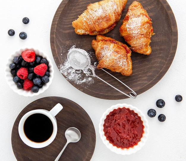 French croissants and forest fruit jam