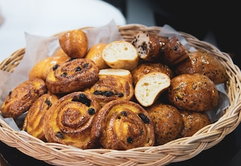 French croissants on wicker basket, bakery background
