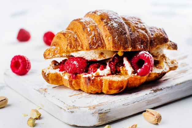French croissants with cream cheese and raspberry