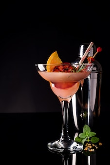 French daiquiri, alcohol cocktail with lemon juice, sugar syrup, cognac, mint and orange