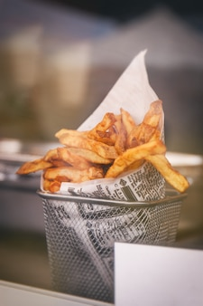 French fries in an aluminum bowl