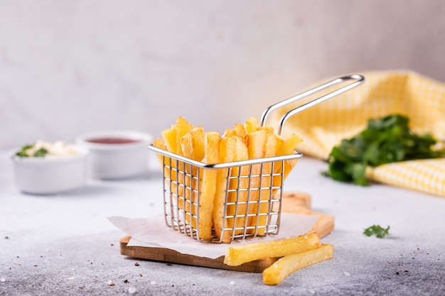 French fries in a basket on modern