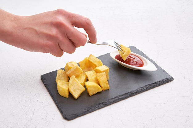 French fries on black slate plate