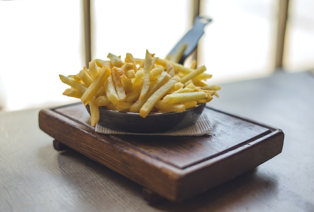 French fries in frying pan