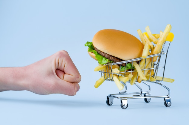 French fries and hamburger for snack. fast food addiction. fighting overweight and obesity. refusal of junk, unhealthy food