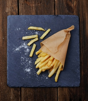 French fries in paper wrapper