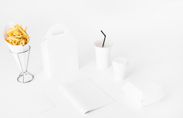 French fries; parcel and disposal cup on white backdrop