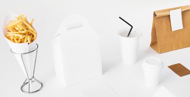 French fries; parcel and disposal cup on white background