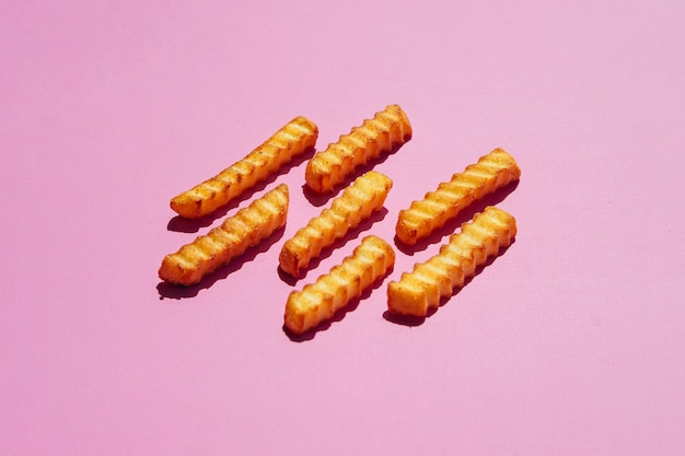 French fries on pink background