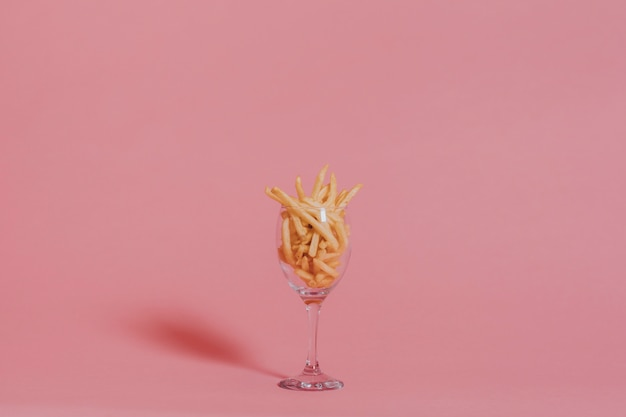 French fries on pink