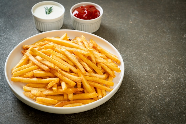 French fries or potato chips with sour cream and ketchup