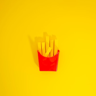 French fries replica over yellow background