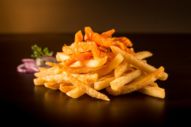 French fries and sweet potatoes with onion