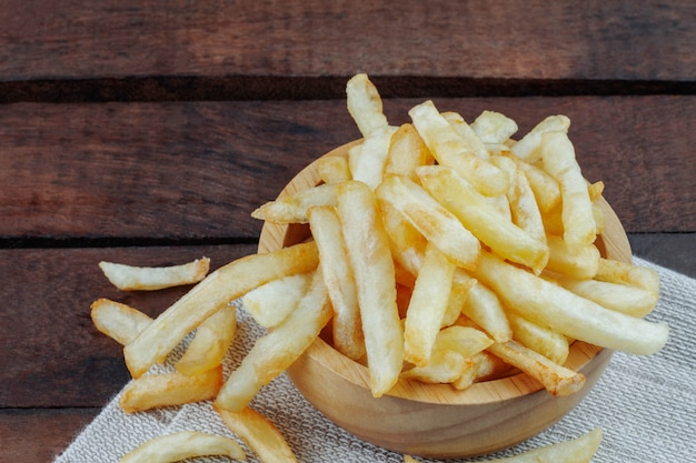 French fries on tablecloth.