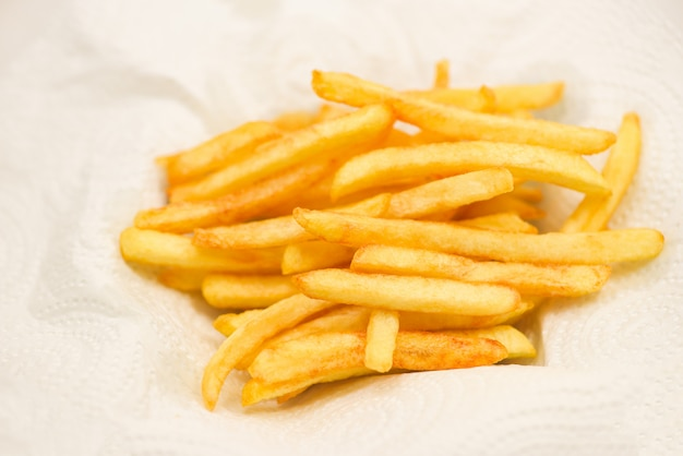 French fries on white paper