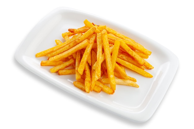 French fries on a white rectangular ceramic plate. white background. isolated.