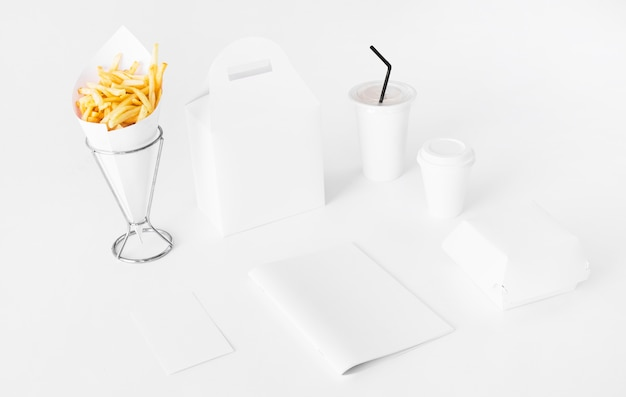 French fries with food package and disposal cup