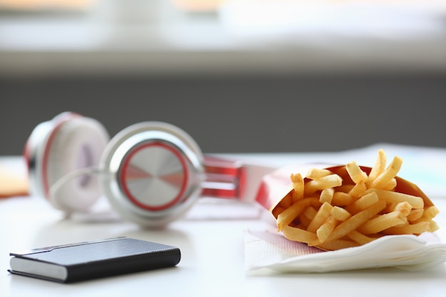 French fries with headphones lying on