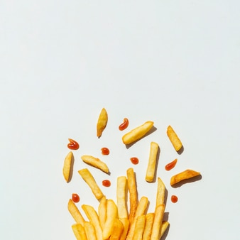French fries with ketchup on gray background