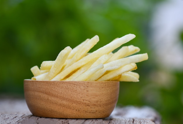 French fries in wooden bowl