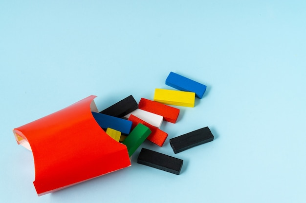 French fry concept with a colorful wooden cuboid shape.