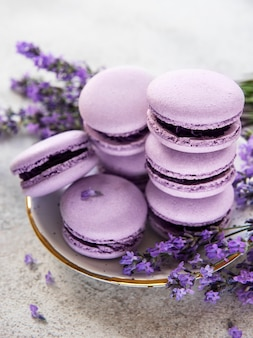 French macarons with lavender flavor and fresh lavender flowers