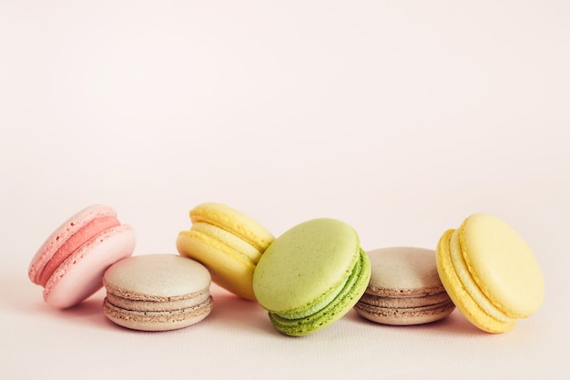 French macaroons cookies set with different flavors. holidays food concept with copy space.