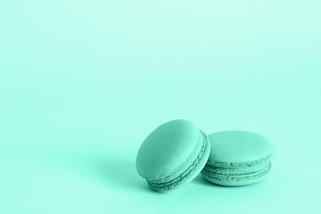 French macaroons cookies in trendy colors. holidays food concept with copy space.