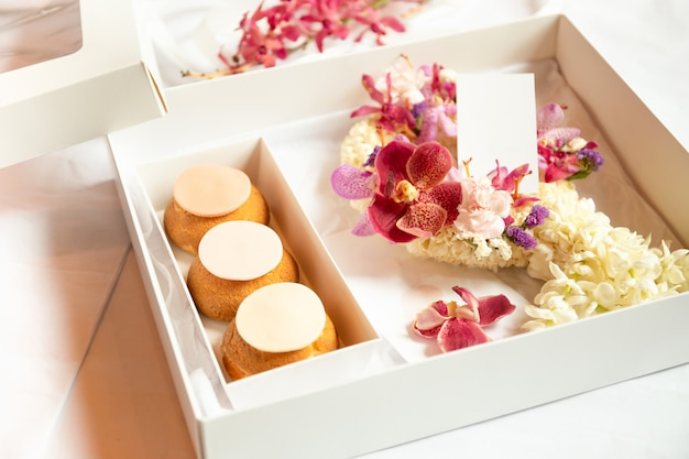French profiteroles in gift box with flower for ocation.