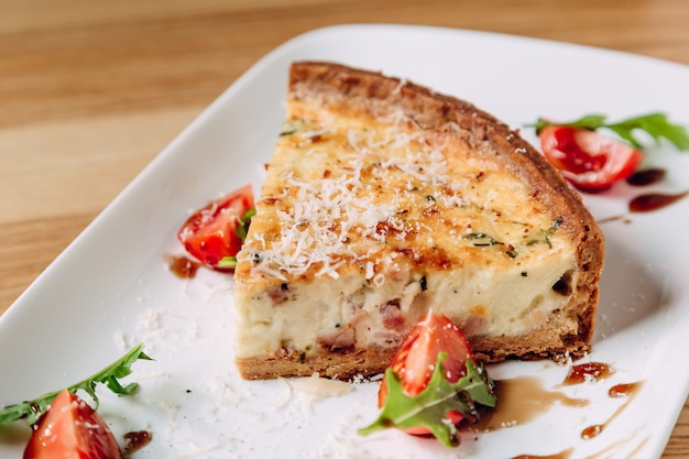 French quiche lorraine with tomatoes and mozzarella cheese