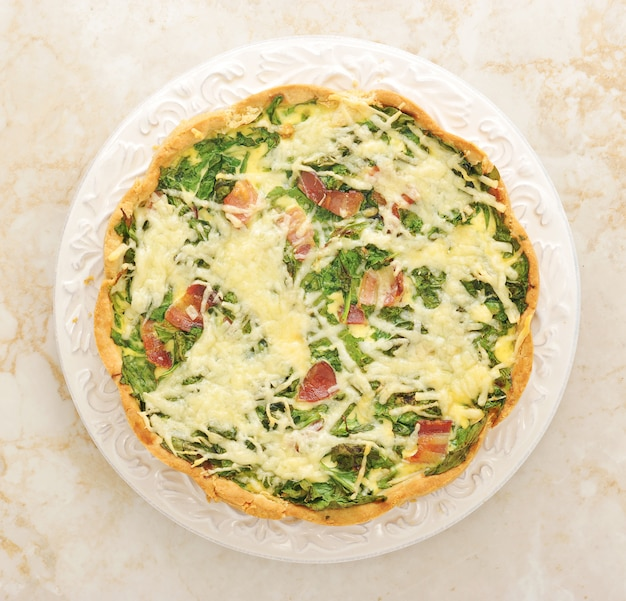 French quiche pie with egg, cheese and spinach