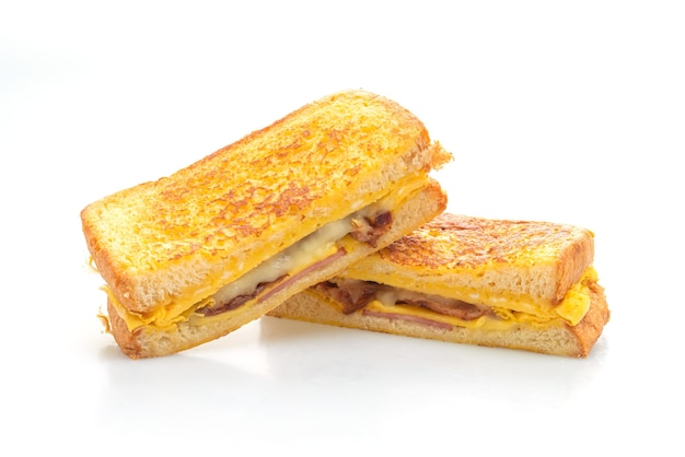 French toast ham bacon cheese sandwich with egg isolated