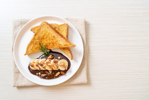 French toast with banana chocolate and almonds for breakfast
