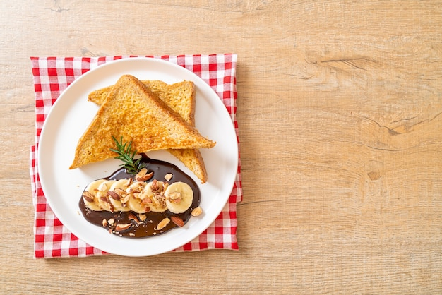 French toast with banana, chocolate and almonds