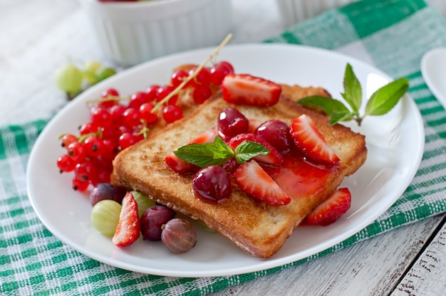 French toast with berries and jam for breakfast