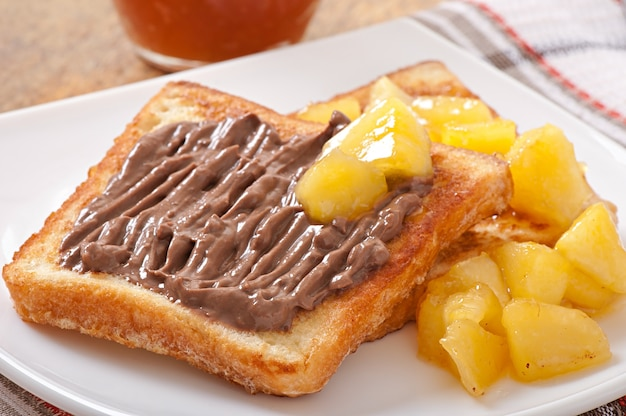 French toast with caramelized apples and chocolate cream for breakfast