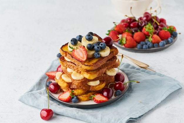 French toasts with berries and banana