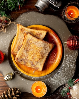 French toasts on a wooden plate