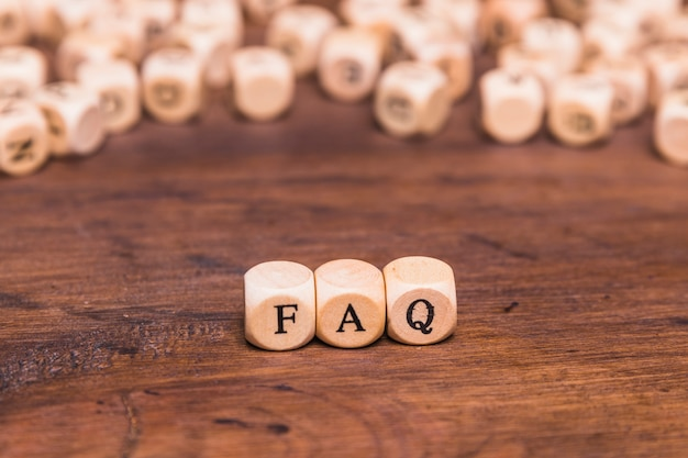 Frequently asked questions concept made with wooden blocks
