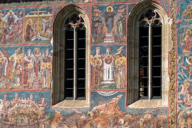 Frescos on the exterior of the monastery in moldovita in moldovia romania on september 18, 2018