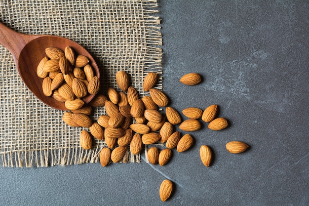 Fresh almond on wooden spoon with copy space. food and healthy concept