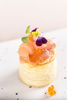 Fresh appetizer with smoked salmon and caviar, on pastry