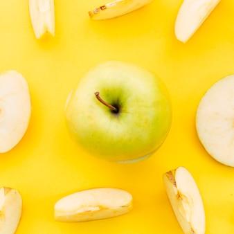 Fresh apple on bright surface