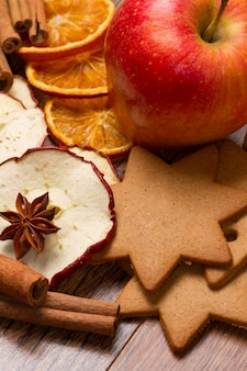 Fresh apple with biscuit,cinnamon and fruit dried